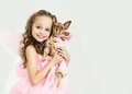 Blond kid girl with small pet dog blondy in fairy dress Royalty Free Stock Photo