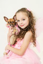 Blond kid girl with small pet dog in pink pixie dress Royalty Free Stock Image