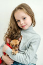 Blond kid girl with small pet dog russian toy Royalty Free Stock Photos