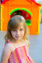 Blond kid girl smiling in outdoor playground Stock Images