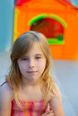 Blond kid girl smiling in outdoor playground Royalty Free Stock Photo