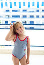 Blond kid girl  swimsuit with hands victory sign Stock Images