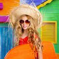 Blond kid surfer girl tropical vacations with sunglasses and beach hat Royalty Free Stock Photography