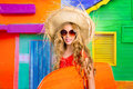 Blond kid surfer girl tropical vacations with sunglasses and beach hat Royalty Free Stock Image