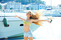 Blond kid teen girl in Mediterranean port Spain Royalty Free Stock Photo
