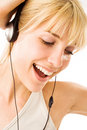 Blond Listening To Music Stock Image