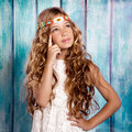 Blond little girl thinking in vintage  wood background Royalty Free Stock Photo