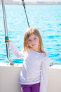 Blond little kid girl sailing in a boat smiling Royalty Free Stock Images