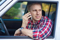 Blond Man in Car On Cell Phone Royalty Free Stock Images