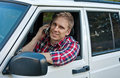 Blond Man in Car On Cell Phone Royalty Free Stock Photos