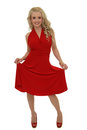 Blond model in red dress pretty young with long curly hair pulling her up Stock Photography
