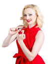 Blond pinup woman in red dress making manicure young beautiful smiling doing Stock Image
