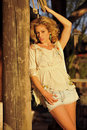 Blond on Rustic Column Stock Photo