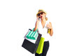 Blond shopaholic woman bags and smartphone with talking with on white background Royalty Free Stock Photography