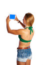 Blond short jeans sexy woman selfie tablet photo Royalty Free Stock Photo