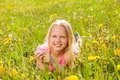Blond smiling cute girl in yellow flowers portrait summer Stock Photo