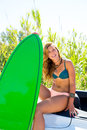 Blond teen surfer girl with green surfboard on car happy california convertible Royalty Free Stock Images