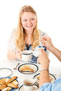 Blond teenage girl at tea party beautiful being served a isolated on white Stock Photo