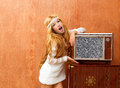 Blond vintage 70s kid girl with retro love old tv Royalty Free Stock Image