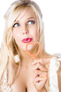 Blond woman blowing bubbles portrait of beautiful young white background Royalty Free Stock Photo
