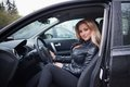 Blond woman in car smiling young sat motor with open door Royalty Free Stock Photo