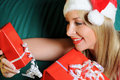 Blond Woman with Christmas Gifts Royalty Free Stock Photography