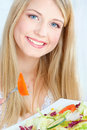 Blond woman eating salad Royalty Free Stock Photo