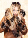 Blond woman with fur coat Royalty Free Stock Images