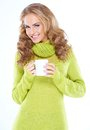 Blond woman holding cup of hot drink Royalty Free Stock Images