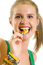Blond woman licking candy Stock Images