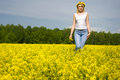 Blond woman outdoor in a yellow field Royalty Free Stock Photography
