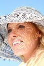 Blond Woman outside with a sunhat Stock Photography