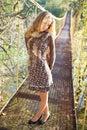 Blond woman posing on the suspension bridge Stock Photo