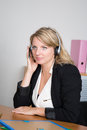 Blond woman receptionist in a business place Royalty Free Stock Photo