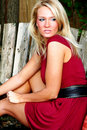 Blond woman with red dress Stock Photo