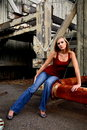 Blond Woman on rusted pipe Royalty Free Stock Photography