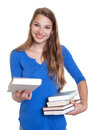 Blond woman showing her favorite book on an isolated white background for cut out Stock Photos