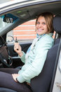 Blond woman showing ignition key Royalty Free Stock Images