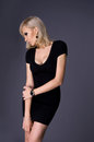 Blond woman in a slinky dress Royalty Free Stock Photo