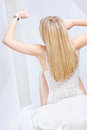 Blond woman stretching and looking at the clock Royalty Free Stock Photo