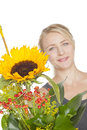 Blond woman with sunflower bouquet Stock Photos