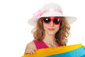 Blond woman with sunglasses at the beach lang hair and behind parasol Royalty Free Stock Image