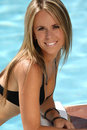 Blond woman in the swimming pool Royalty Free Stock Photos