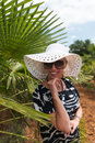Blond woman at tropical travel resort Stock Image