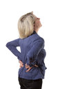 Blond woman with violent backache back pain isolated copyspace Royalty Free Stock Photography