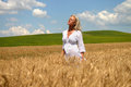 Blond woman in wheat field beautiful young golden summer scene Stock Photos