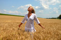 Blond woman in wheat field beautiful young relaxing golden summer scene Stock Photos