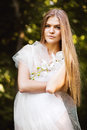 Blond Woman In White On Nature