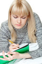 Blond woman writing Stock Photo