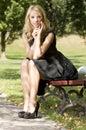 Blond wonam in the garden Royalty Free Stock Image